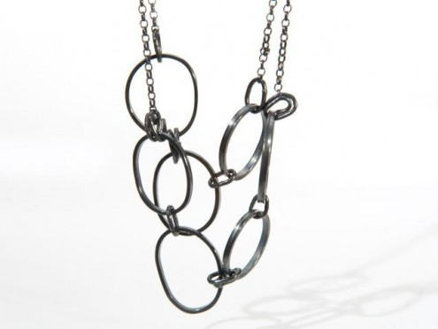 oxi silver pepple and knot necklace